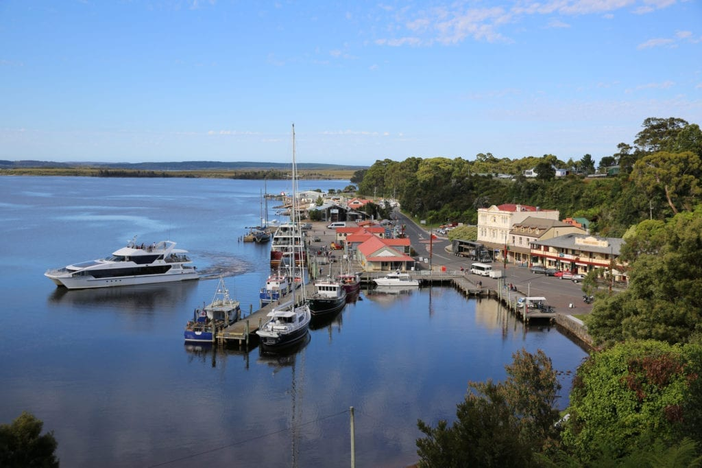 Tasmania itinerary - view overlooking the water to the town of Strahan