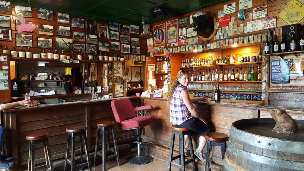 sitting in a bar with hundreds of bottles. Tasmania itinerary