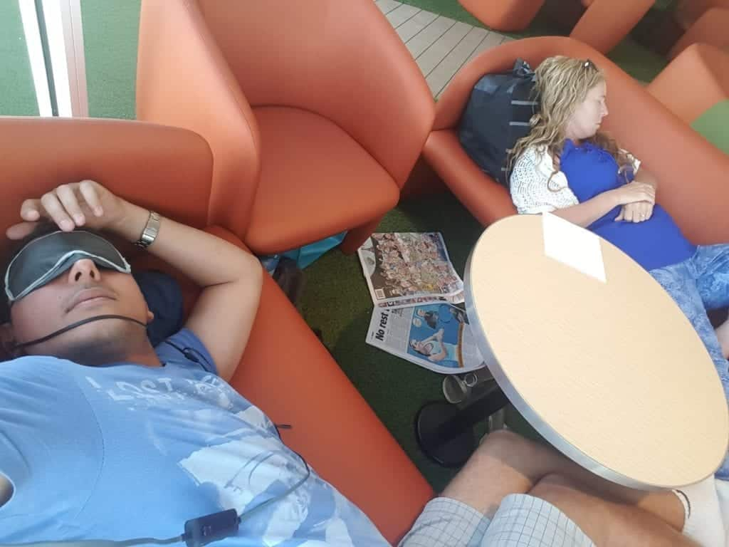 asleep on the couches on a boat. Tasmania itinerary